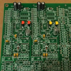 Close-up photo of a synth circuit board with components
