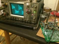 Photo of an oscilloscope testing a Mk II synth circuit board