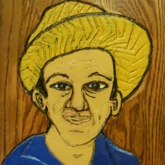 image of a wood carved portrait of Carlos Grasso of Dumfuxx by Charles Gilliam