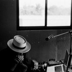 Photo of Carlos Grasso of Dumfuxx playing harmonica.