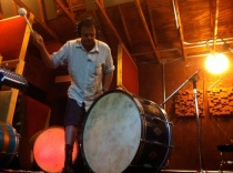 Photo of Carlos Grasso of Dumfuxx playing a big drum.