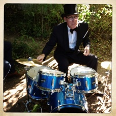 Photo of David Lovering of The Pixies playing drums at a Dumfuxx photo shoot.