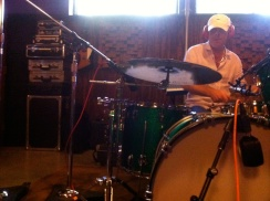 Photo of David Lovering playing drums.