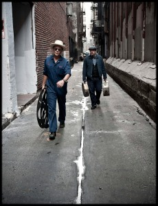 Photo of Carlos Grasso and James Slay of Dumfuxx walk through an alley.