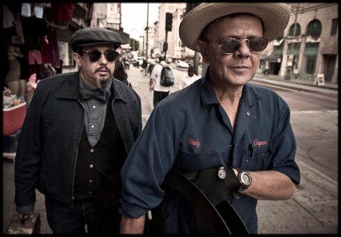 Photo of Carlos Grasso and James Slay strolling down a sidewalk