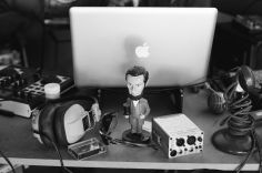 Photo of audio gear and a Lincoln statuette.