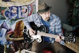 James Slay of Dumfuxx plays guitar at a Dumfuxx rehearsal.