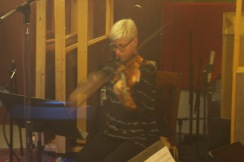 "Photo of Lauren Chipman playing viola at Little Box Studios for the Dumfuxx score to ""Asphalt Serenade""."