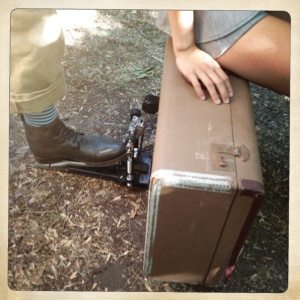 Photo of a shoe operating a kick drum pedal on a suitcase with Daphne Chen