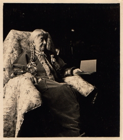 Photo of an old woman sitting in a chair