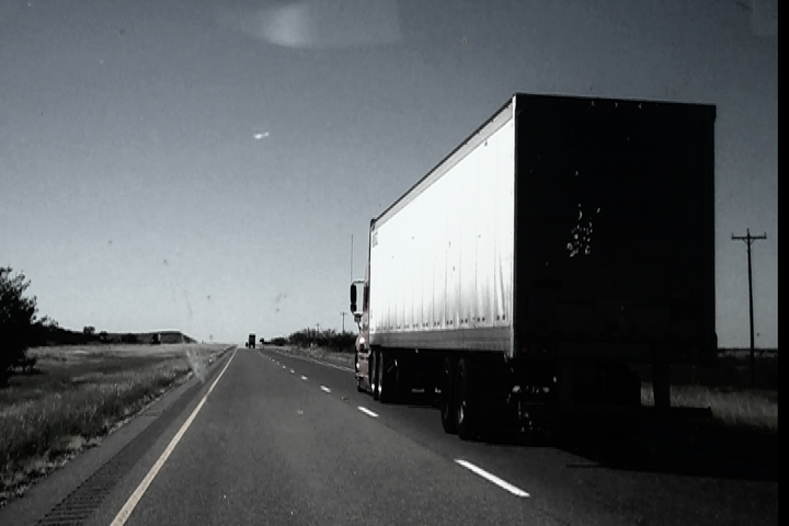 Image of a truck on the highway